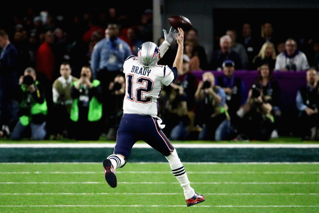 Tom Brady of the New England Patriots misses the catch in the second quarter of Super Bowl LII. (Getty Images)