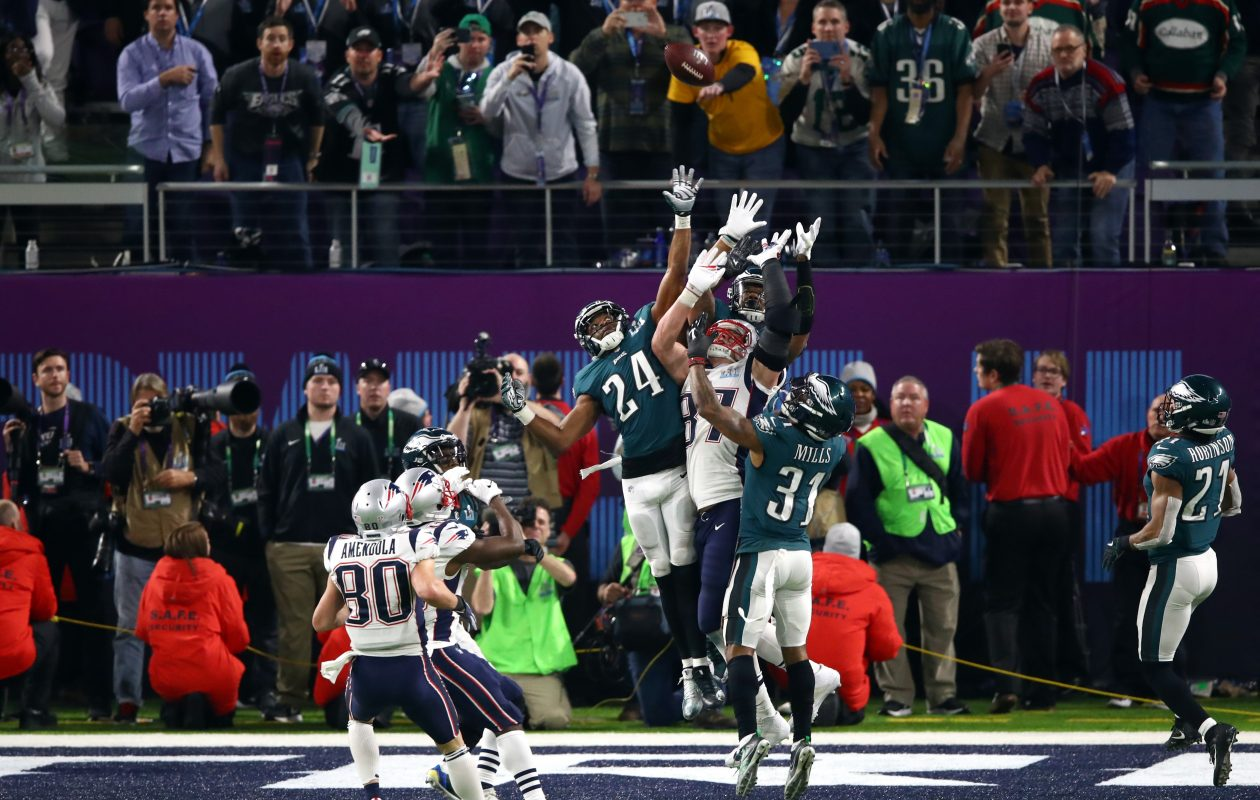Corey Graham (24) and Jalen Mills of the Philadelphia Eagles go up for a hail mary against Rob Gronkowski on the last play. (Gregory Shamus/Getty Images)