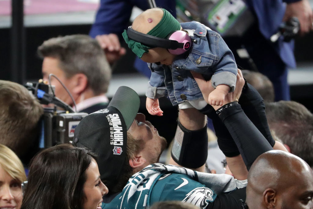 Nick Foles of the Philadelphia Eagles celebrates with his daughter Lily Foles after his 41-33 victory over the New England Patriots in Super Bowl LII. (Getty Images)