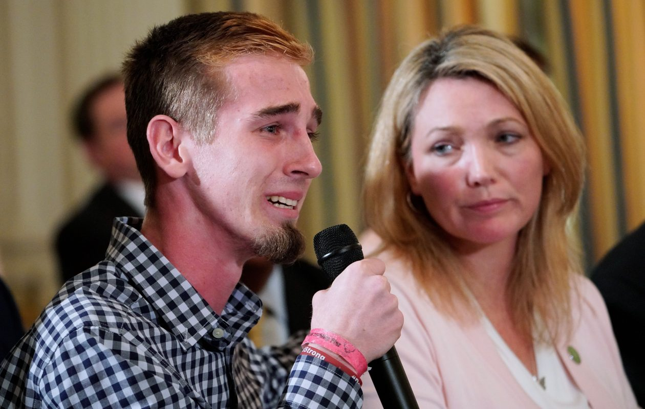 Marjory Stoneman Douglas High School shooting survivor Samuel Zeif speaks during a listening session on gun violence with President  Trump on Feb. 21, 2018. At right is Nicole Hockley, parent of a Sandy Hook shooting victim.  (MANDEL NGAN/AFP/Getty Images)