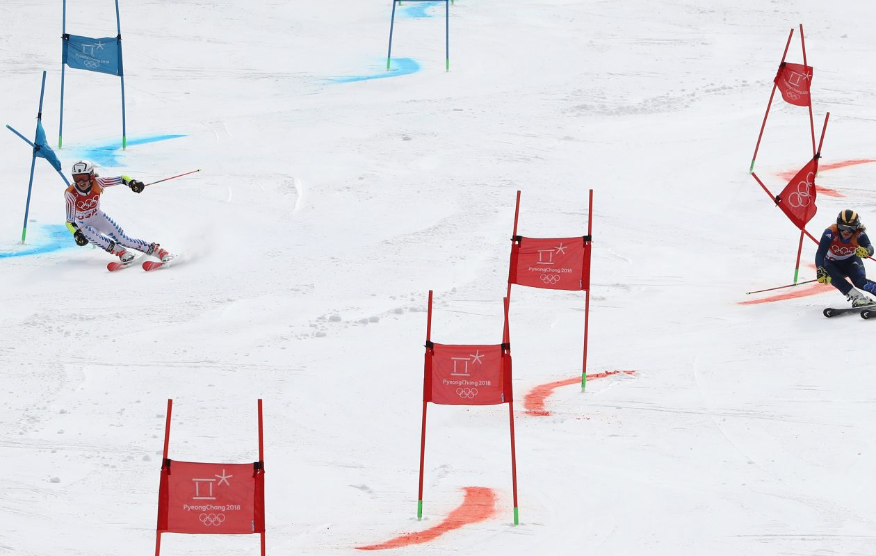 Tricia Mangan (left) races against Britain's  Alex Tilley in the Alpine team event. (Ezra Shaw/Getty Images)