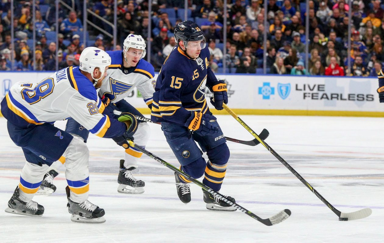 Jack Eichel battles St. Louis' Kyle Brodziak for the puck in the first period (James P. McCoy/Buffalo News).