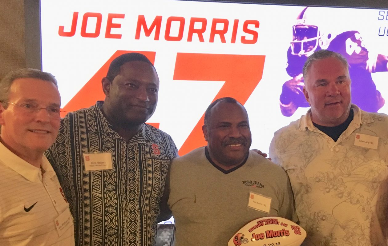Syracuse announces it will retire Joe Morris' No. 47 jersey. From left is Athletic Director John Wildhack, coach Dino Babers, Morris and ex-teammate John Lally, formerly of Clarence. (photo courtesy of Laura Lally)
