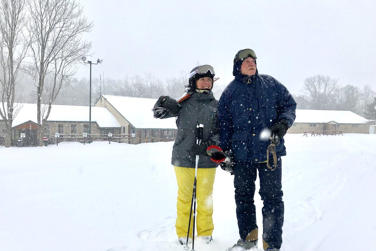 Today's snow is great news for skiers. Martha Mathews and David Paschke watch the slope at Kissing Bridge this morning. (Robert Kirkham/Buffalo News)