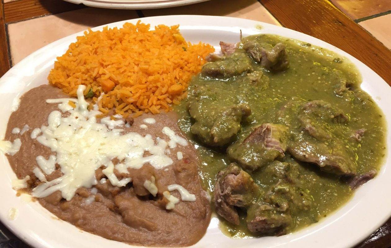 Carnitas en salsa verde ($12.99) is seasoned tender pork with hot tomatillo sauce, served with rice, beans, guacamole salad and tortillas. (Ben Tsujimoto/Buffalo News)