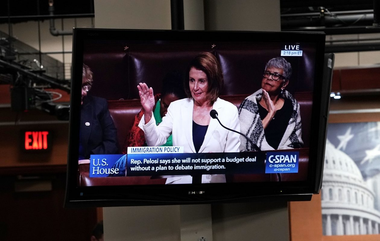 A TV shows U.S. Minority Leader Rep. Nancy Pelosi (D-CA) giving an immigration speech Wednesday on the House floor during the opening press conference for the 2018 House Democratic Issues Conference.(Alex Wong/Getty Images)