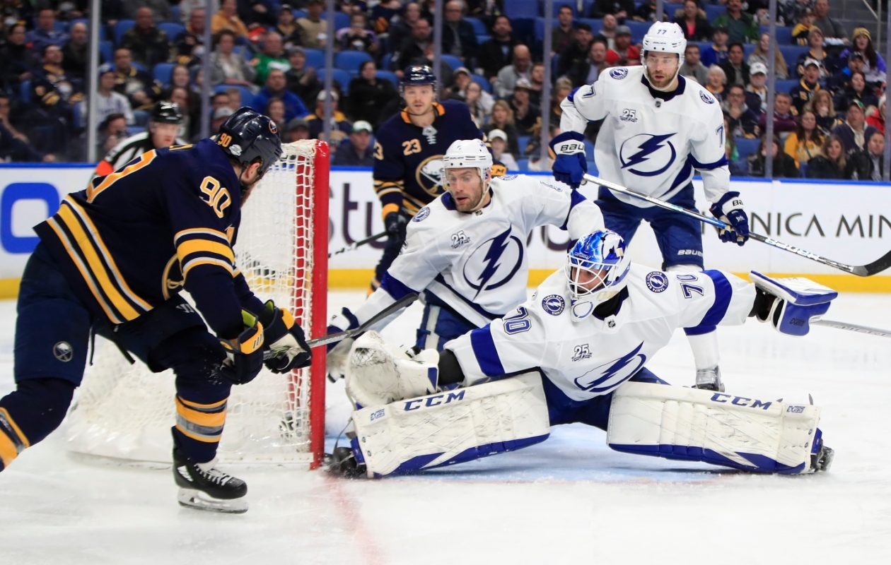 Ryan O'Reilly takes a puck off the boards and backhands home the game-winning goal past Tampa Bay's Louis Domingue. (Harry Scull Jr./Buffalo News)