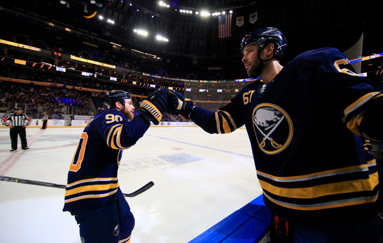 Benoit Pouliot, right, gives it up to Ryan OReilly after OReilly scored in the third period Sunday against Colorado (Harry Scull Jr./Buffalo News).