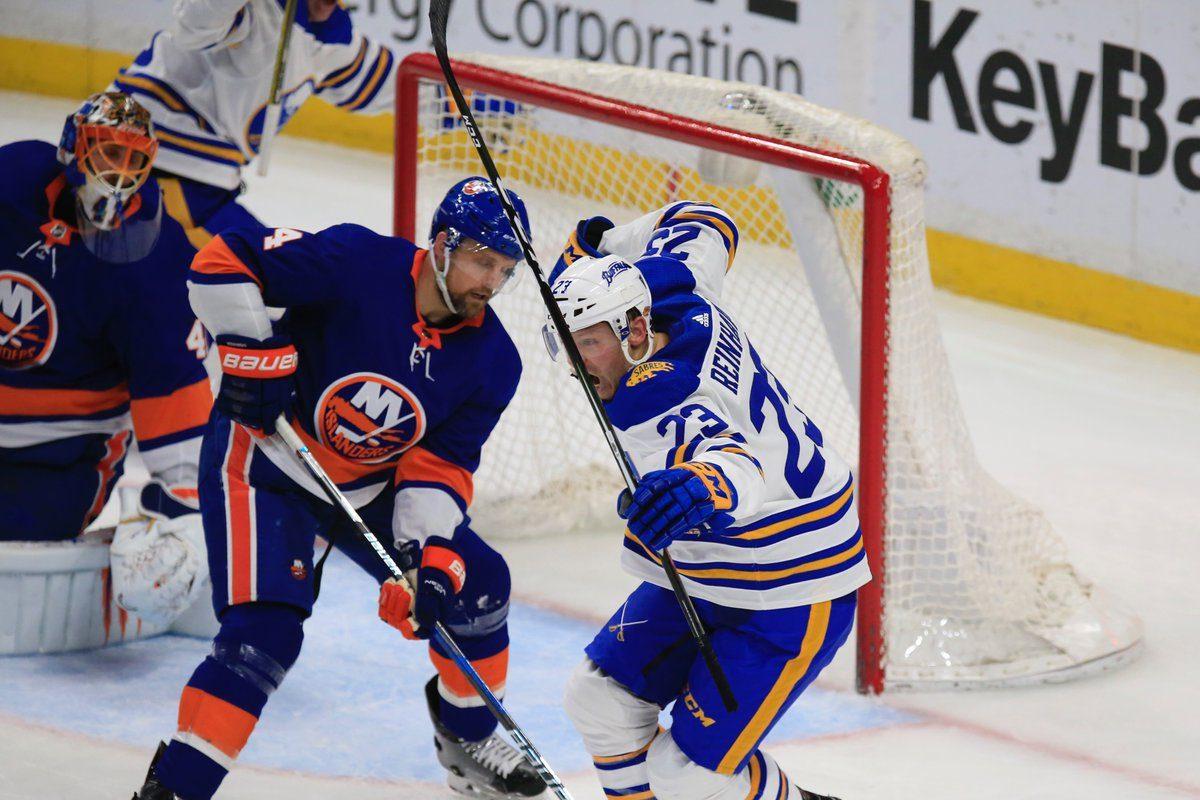Sam Reinahrt celebrates the game-winning goal in front of Islanders defenseman Dennis Seidenberg (Harry Scull Jr./Buffalo News)