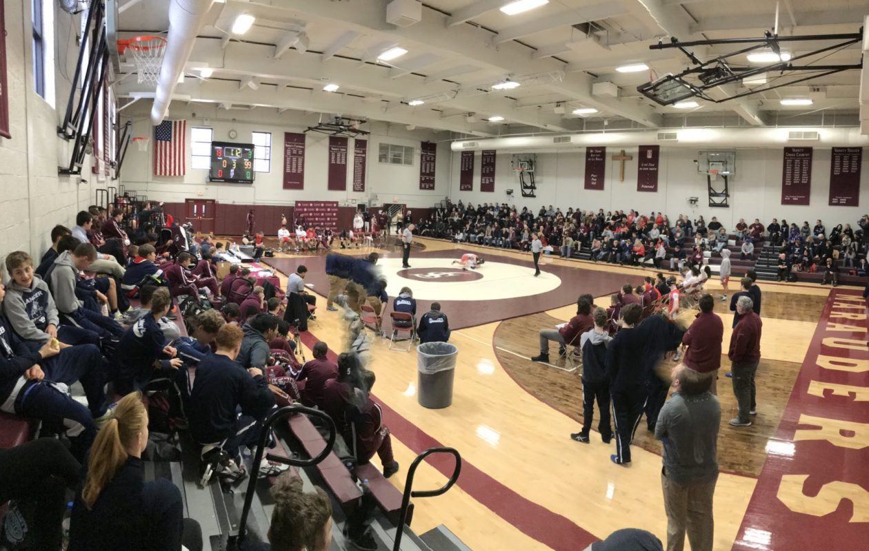 A packed house watched as host St. Joe's secured its fourth straight All-Catholic wrestling title Sunday. (Photo courtesy of @SJCIWrestling Twitter)