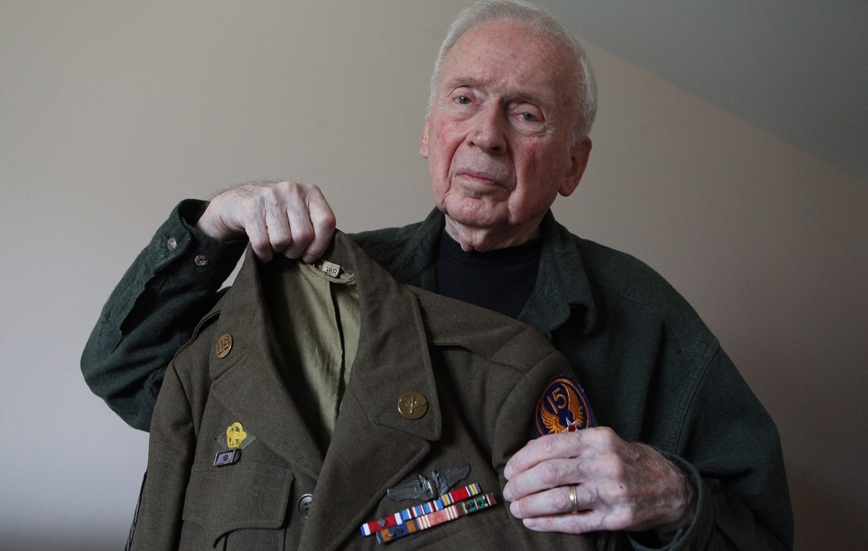 William Hess, of Derby, holds his uniform from his service as a ball turret gunner in the U.S. Air Force during World War II,  April 10, 2012.  (Buffalo News file photo)