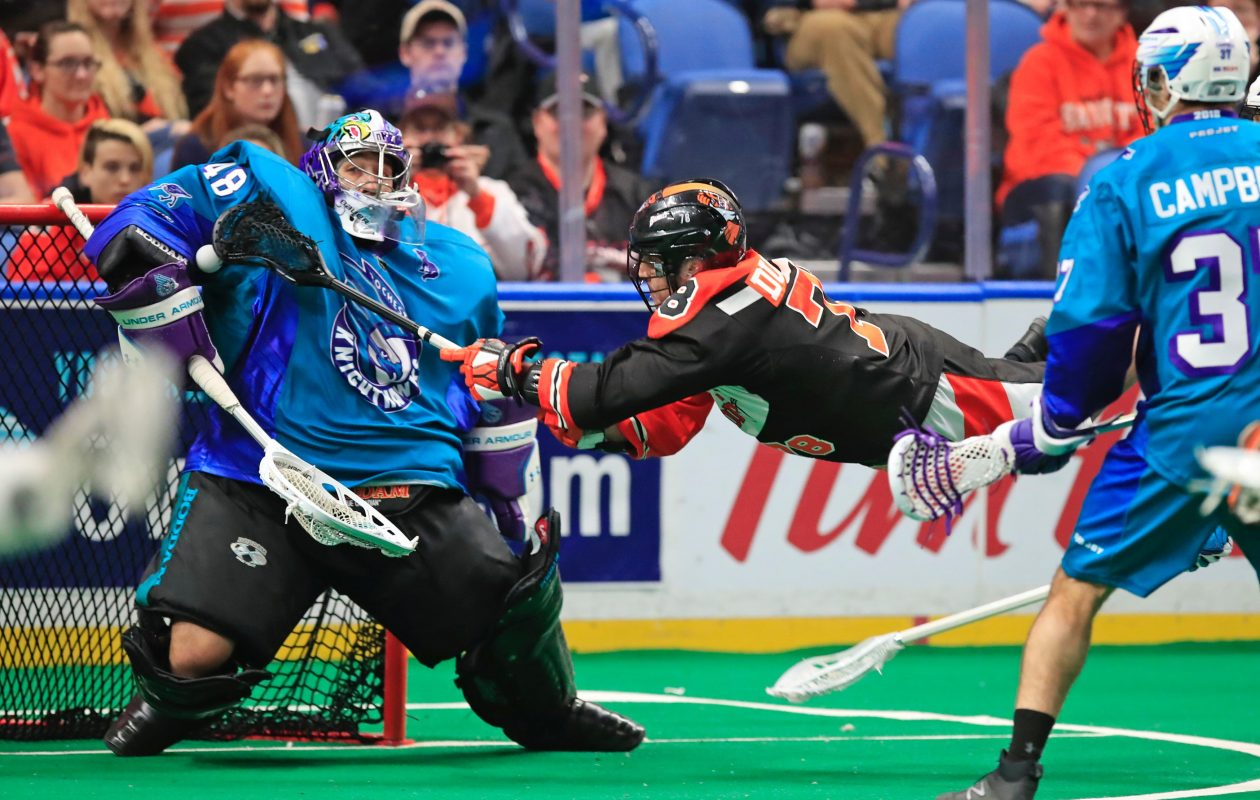Rochester goalie Matt Vinc makes a save on diving Buffalo Bandits forward Jordan Durston in the Knighthawks' 17-10 victory Saturday. (Harry Scull Jr. / Buffalo News)