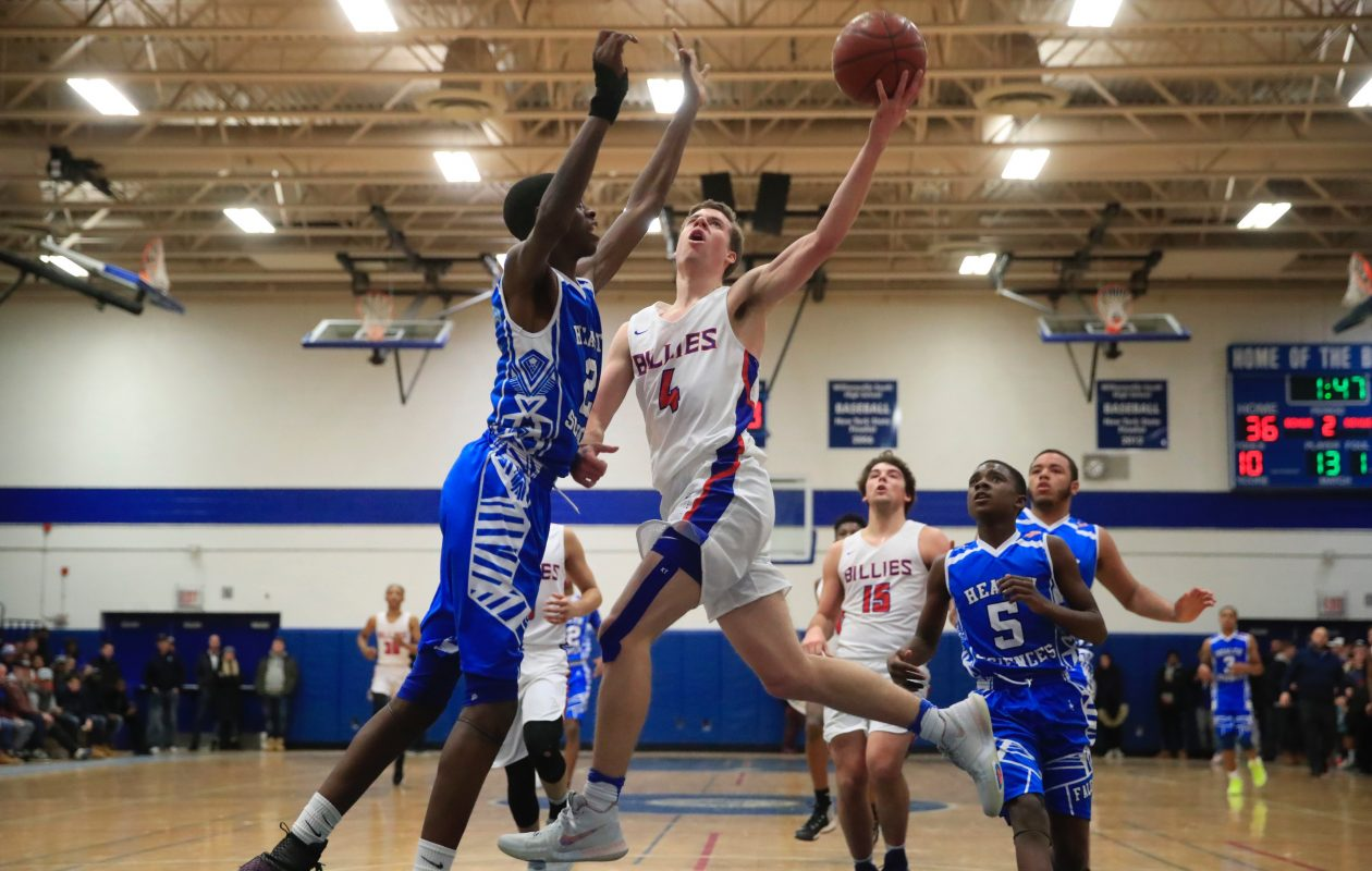Williamsville South's Greg Dolan goes to the basket against Health Sciences Davonte Gaines during the South's victory in the Centercourt Classic on Saturday. (Harry Scull Jr./Buffalo News)