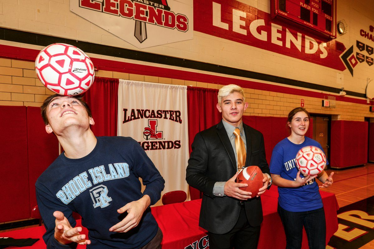 Zach Drayer, Joe Andreessen and Andrea 'Annie' Judasz of Lancaster were among the area's scholastic talents to make their college commitments official on National Signing Day on Wednesday. (James P. McCoy/Buffalo News)