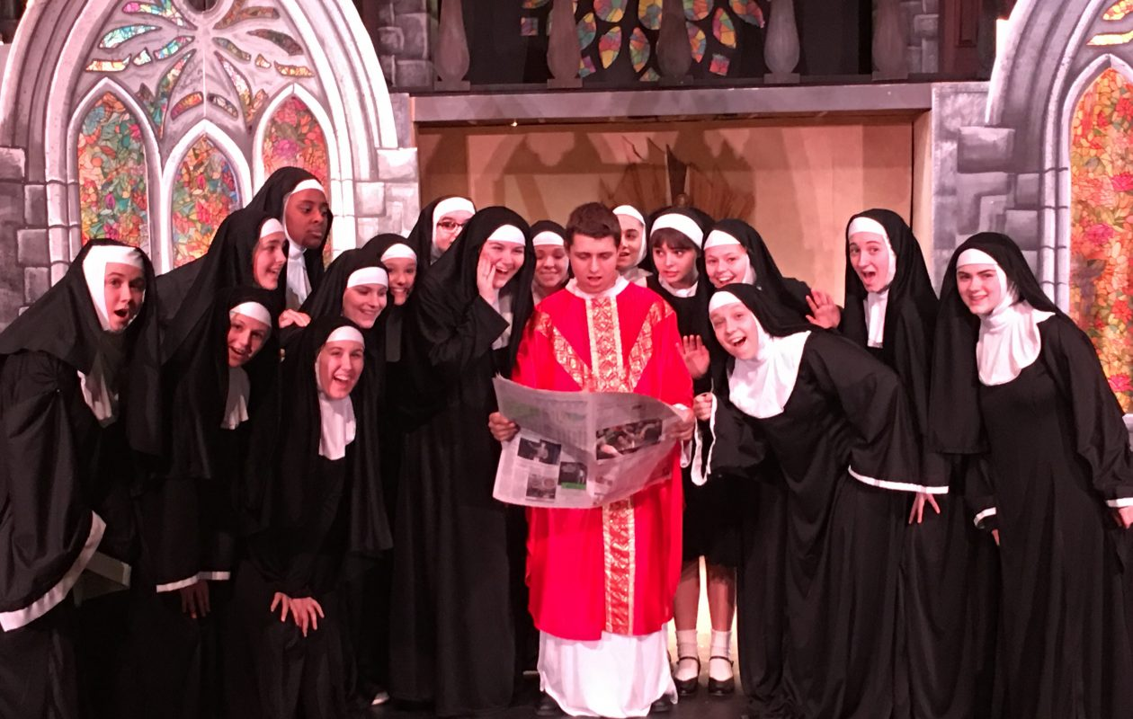 Monsignor O'Hara and the singing and dancing nuns read their reviews in the paper.