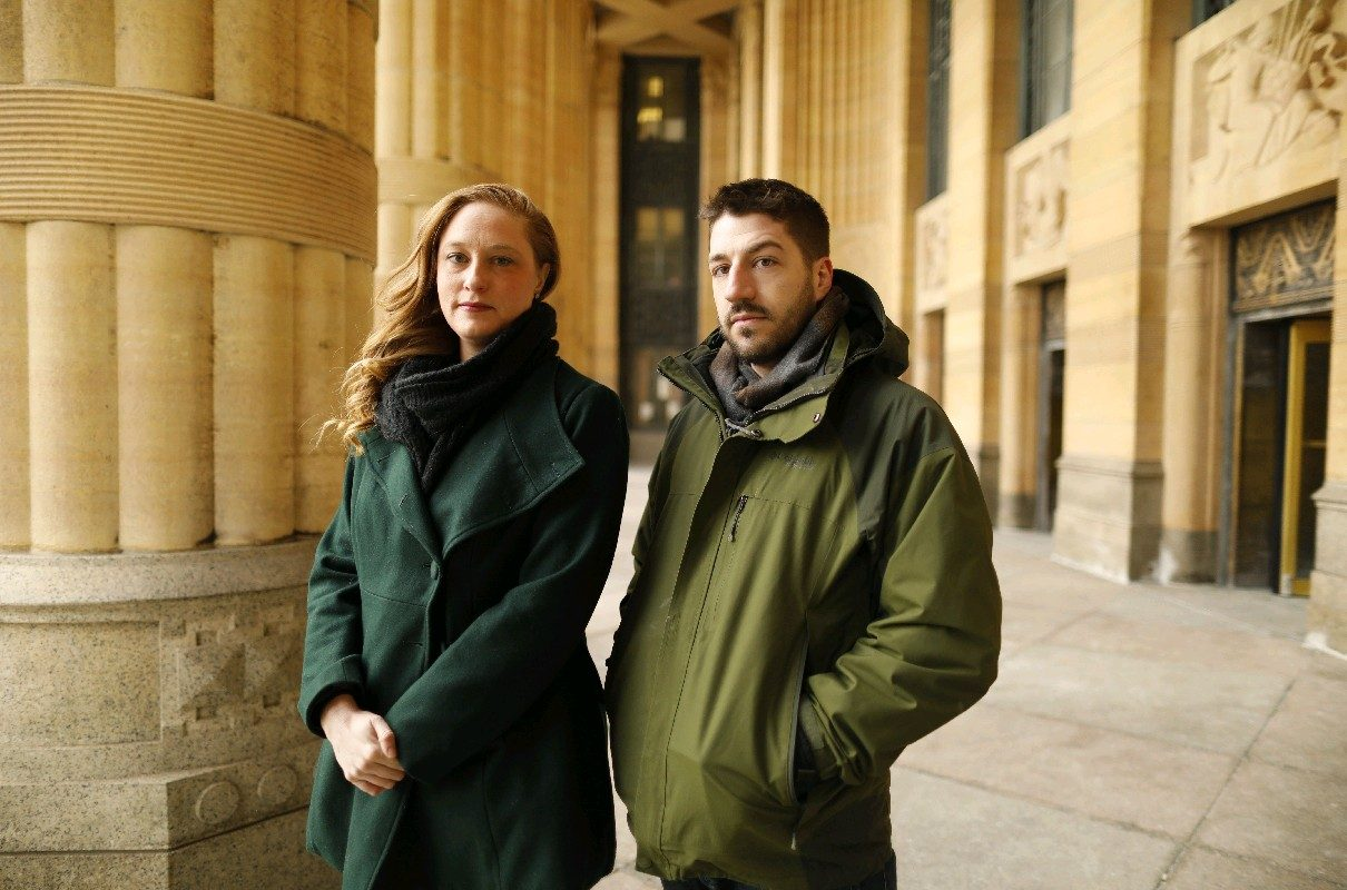 Katie Long and Chris Keroack, plaintiffs in a suit against restaurant William Ks for failing to pay Buffalo's  living wage, stand outside City Hall, where elected officials changed the law to allow restaurant workers to be paid less. (Derek Gee/Buffalo News)