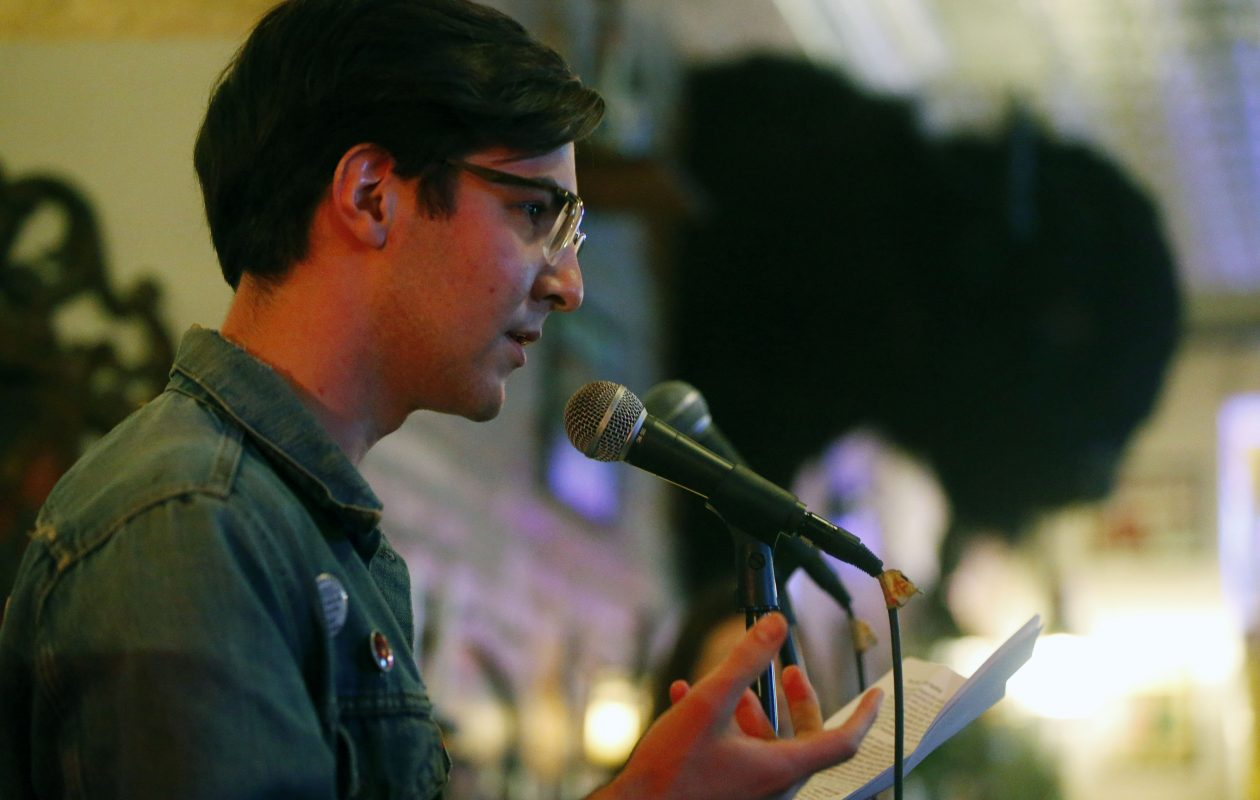 Aidan Ryan, pictured in a 2017 poetry reading at The Alley Cat, is one of seven readers in a poetry event planned for April 2 in Nietzsche's. (Mark Mulville/Buffalo News file photo)