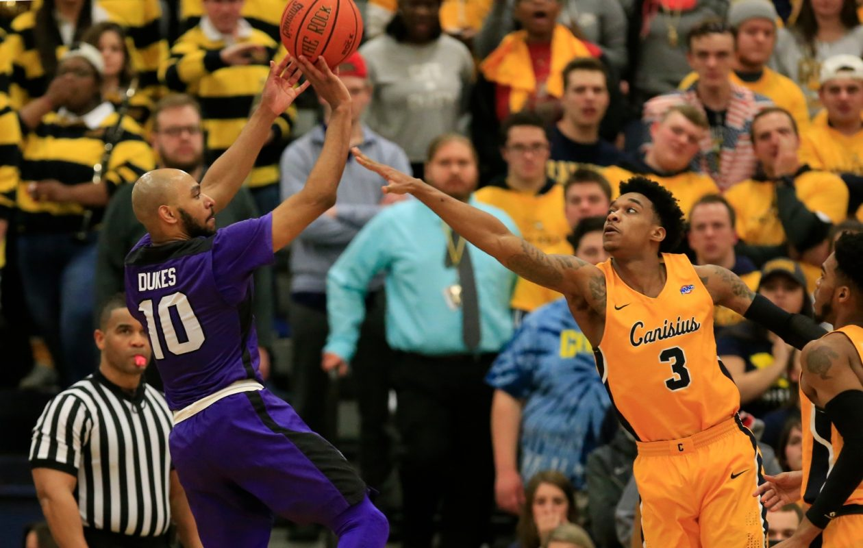 Niagara guard Kahlil Dukes is defended by Canisius Jonathan White as he shoots during second half action at the Koessler Center on Saturday, Jan. 27, 2018. (Harry Scull Jr./Buffalo News)
