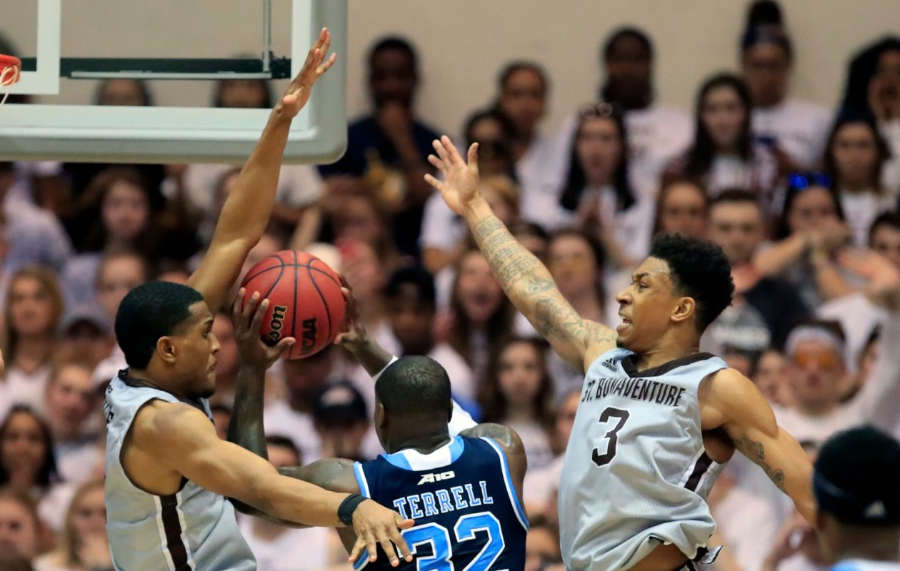 St. Bonaventure's Matt Mobley and Jaylen Adams defend Rhode Island's Jared Terrell during second half action at the Reilly Center on Friday, Feb. 16, 2018. (Harry Scull Jr./Buffalo News)