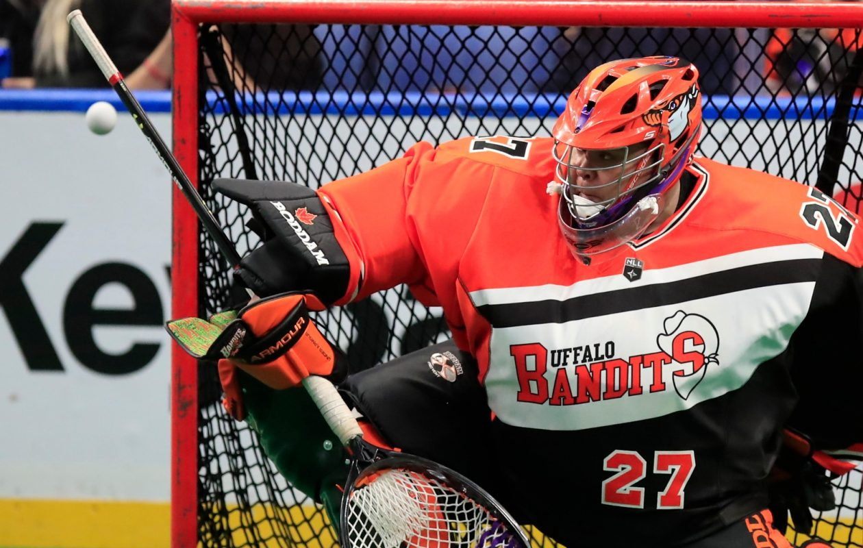 Buffalo Bandits goaltender Alex Buque makes a save against the Rochester Knighthawks during first half action at the KeyBank Center on Saturday, Feb. 24, 2018.  Buffalo Bandits goaltender Alex Buque makes a save against the Rochester Knighthawks during first half action at the KeyBank Center on Saturday, Feb. 24, 2018. (Harry Scull Jr./Buffalo News)