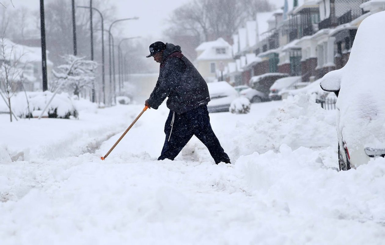 Jerell Goree of Beverly Road on Buffalo's East Side almost got stuck trying to get out of his driveway, so he has to shovel the street so he can get out.Sharon Cantillon/Buffalo News