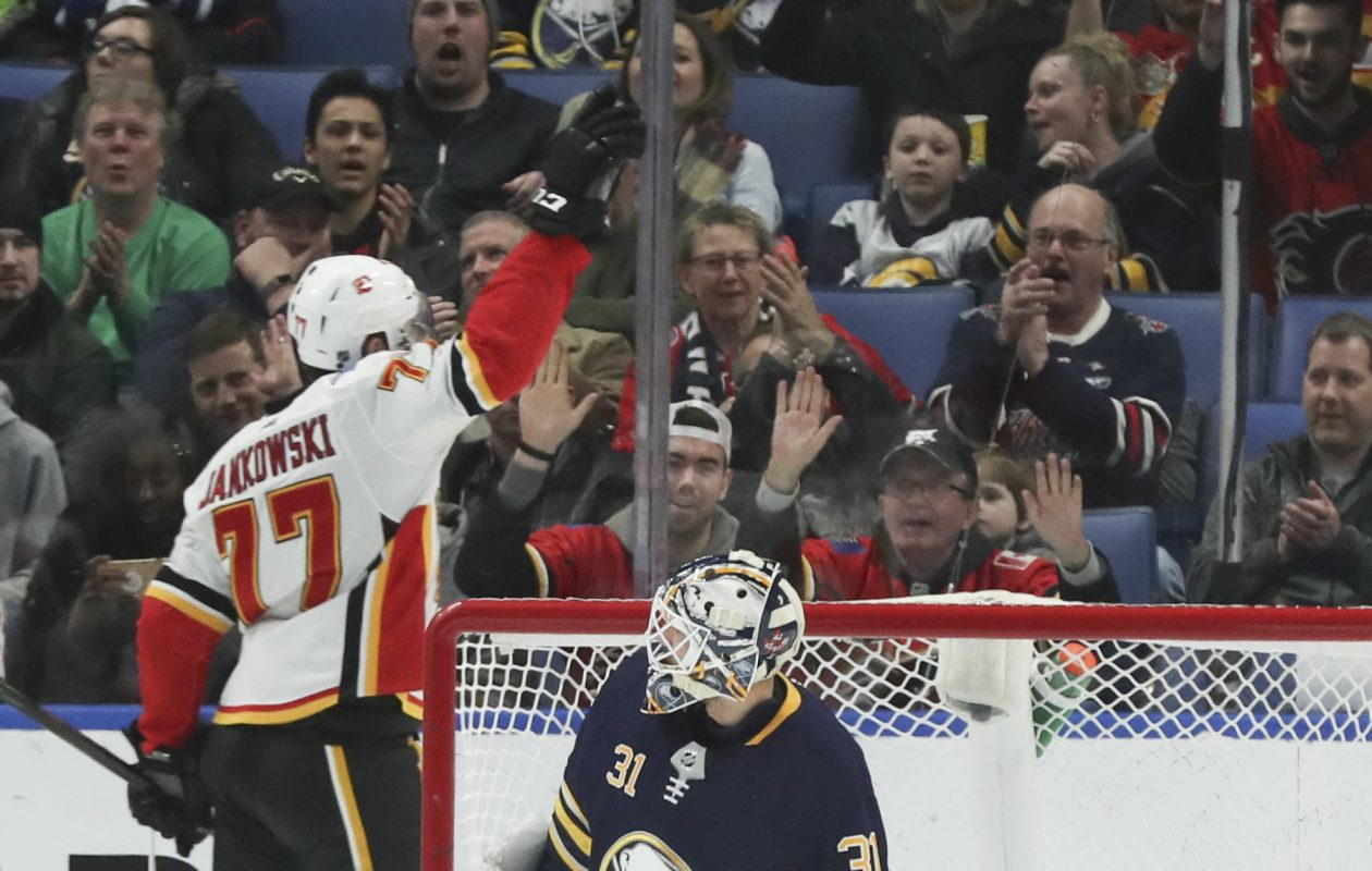 Mark Jankowski and the Flames celebrated often against the Sabres and goalie Chad Johnson. (James P. McCoy/Buffalo News)