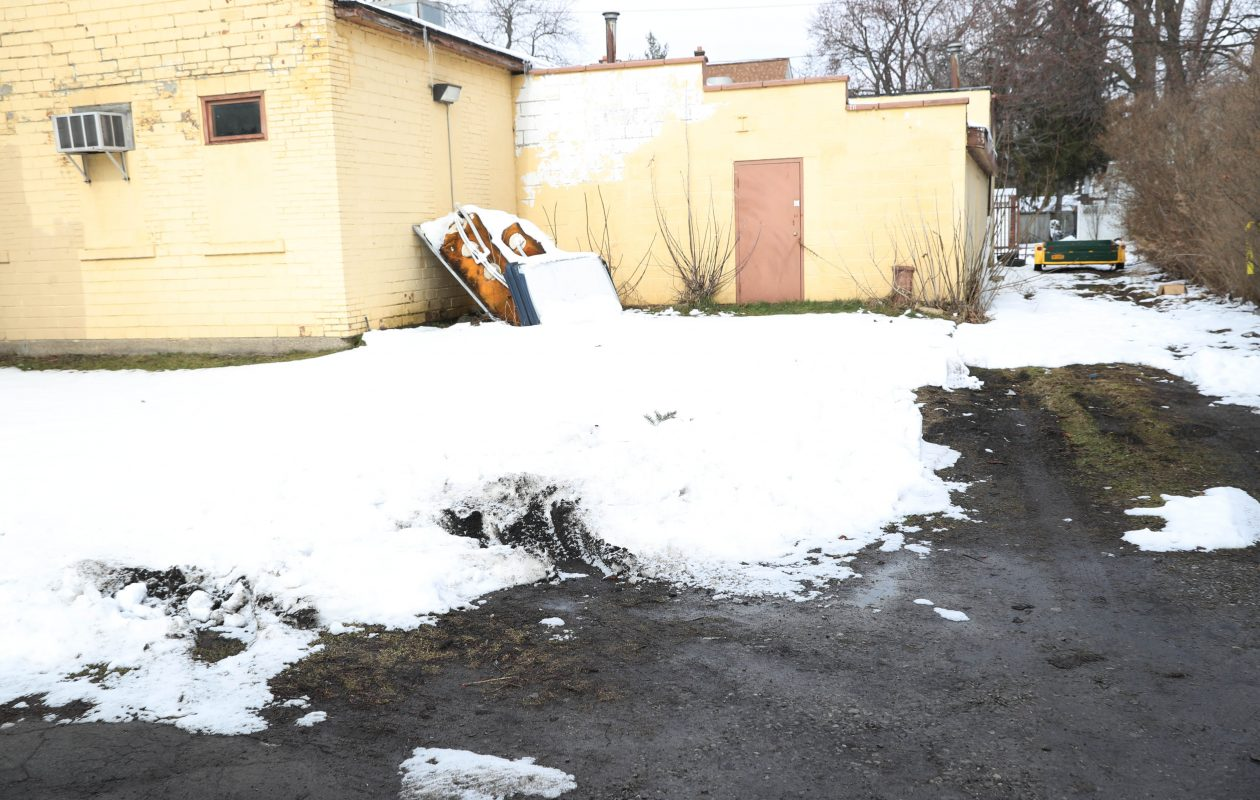 An alley between 14th and 15th Avenue near Oliver Street was the scene of a fatal accident  Thursday evening that occurred when a woman tried to free her car from a snowbank with her daughter's help.  On left are two deep ruts in the mud from car tires. (Sharon Cantillon/Buffalo News)