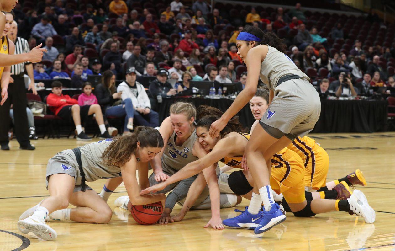 UB's Katherine Ups (5) dives the ball with her teammates.  (James P. McCoy/Buffalo News)