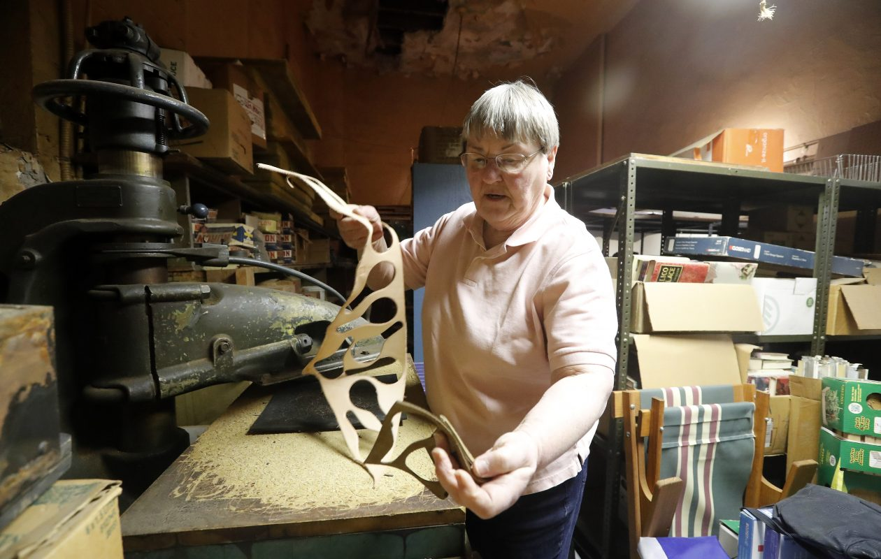 Linda Steffan makes a leather key fob at her shop M. Steffan's Sons on Main Street in Buffalo on Monday, March 19, 2018. (Mark Mulville/Buffalo News)
