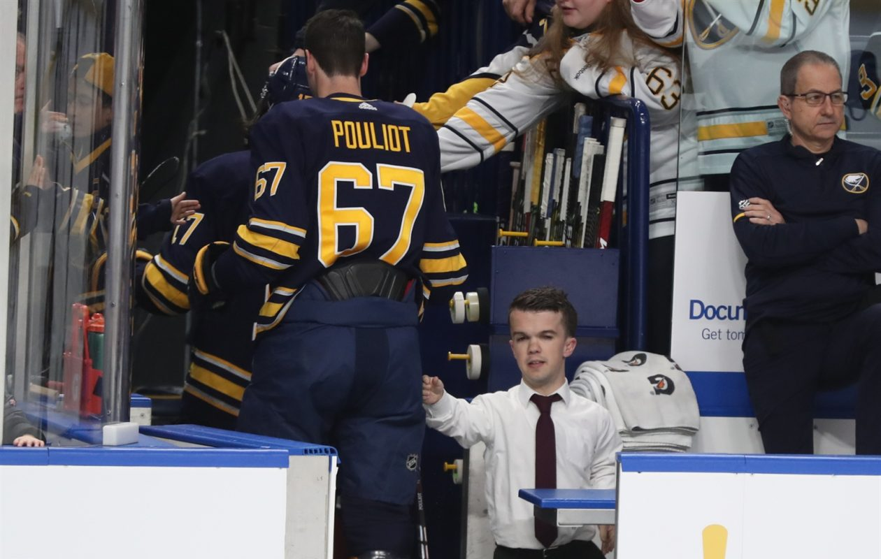 Video coach Mat Myers takes in pregame warmups from the Sabres' bench and encourages players, including Benoit Pouliot. (James P. McCoy/Buffalo News)