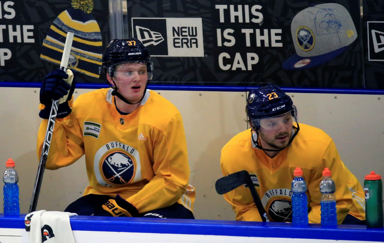 Casey Mittelstadt (left) sits next to another Sabres first-round pick, Sam Reinhart, during Mittelstadt's first practice as a Buffalo Sabre. (Harry Scull Jr./ Buffalo News)