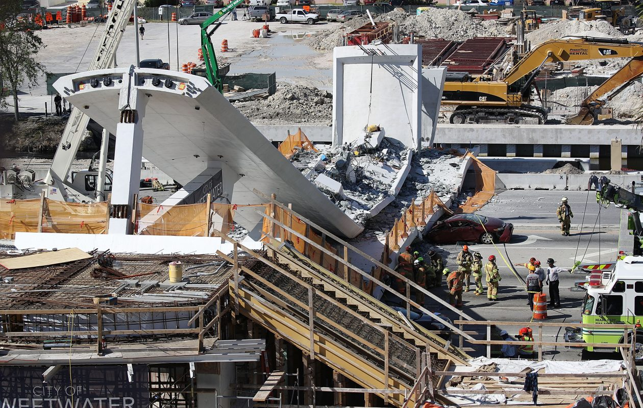 Miami-Dade Fire Rescue Department personnel and other rescue units work at the scene where a pedestrian bridge collapsed a few days after it was built over southwest 8th street on March 15, 2018, in Miami. (Getty Images)