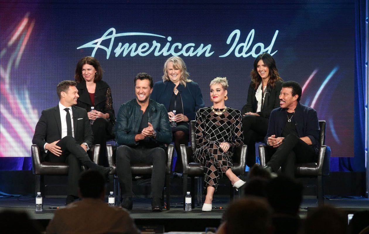 Left to right, back row: 'American Idol' executive producer Jennifer Mullin, showrunner/executive producer Trish Kinane, co-executive producer Megan Michaels Wolflick. Left to right, front row: host Ryan Seacrest, judges Luke Bryan, Katy Perry and Lionel Richie. (Frederick M. Brown/Getty Images)