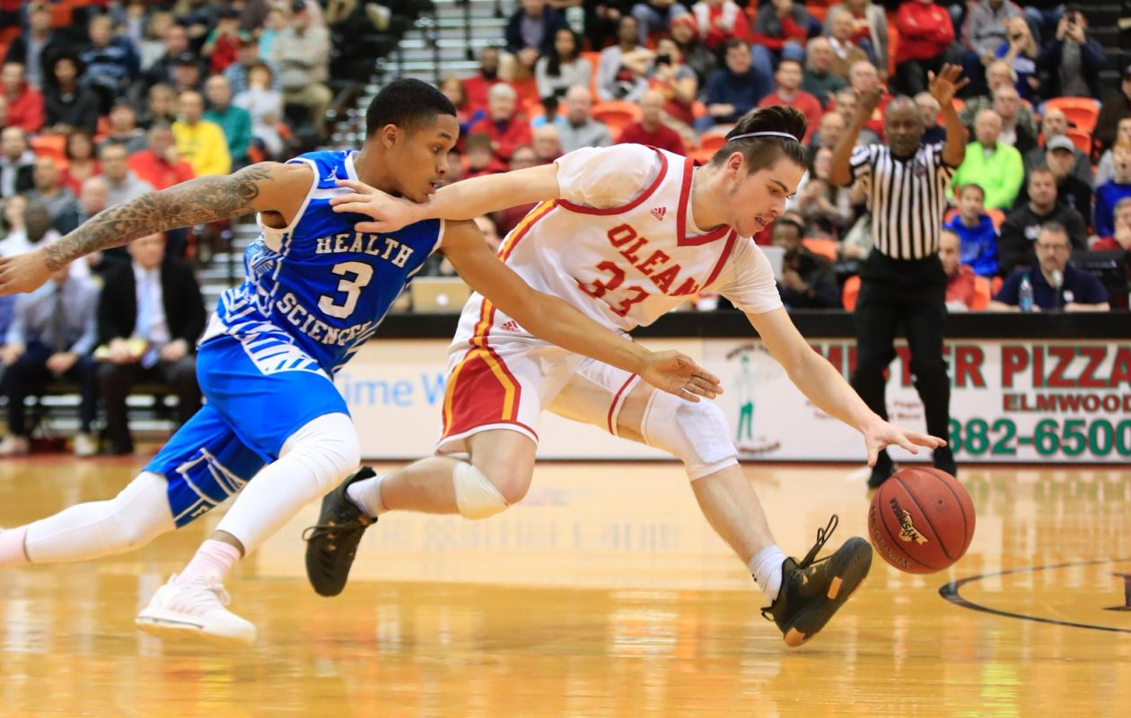 Kameron Briggs forces a jump ball against Olean's Mike Schmidt in the final seconds of Health Sciences' 36-34 Class B final win over the Huskies (Harry Scull Jr./Buffalo News)