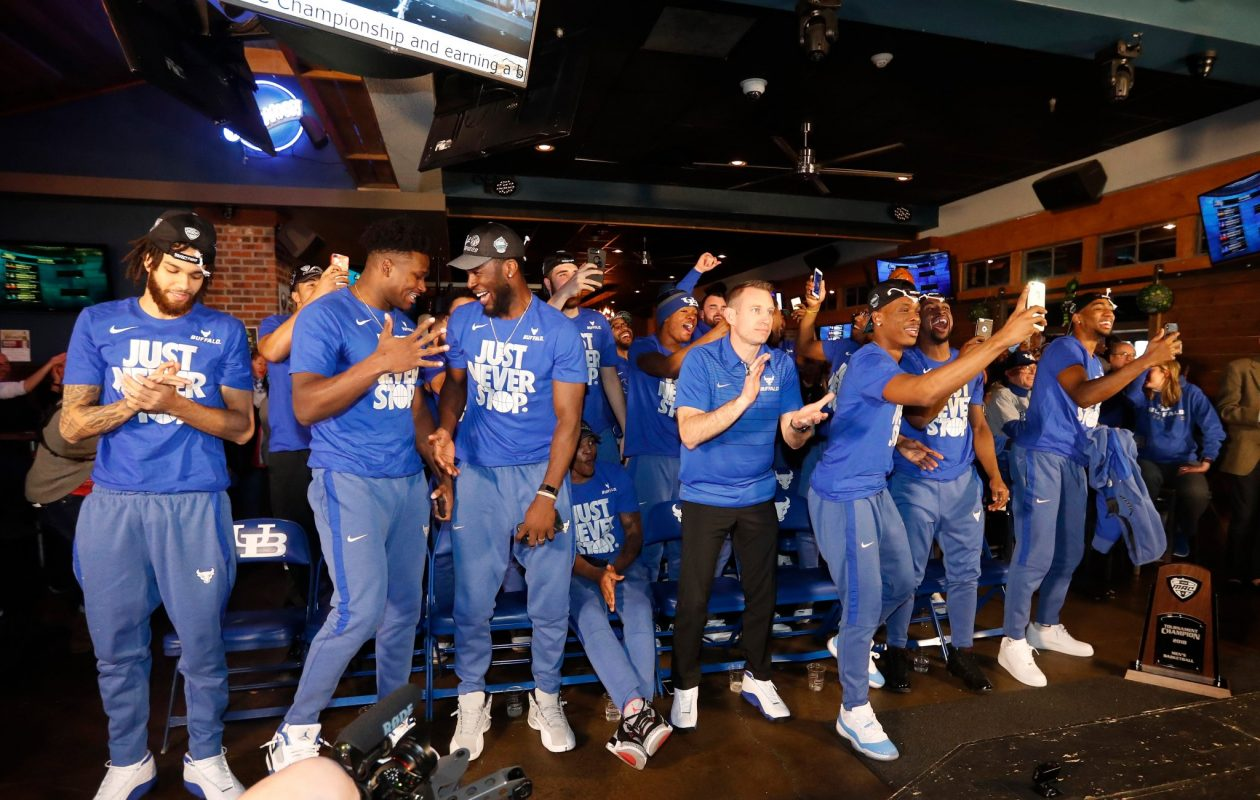 UB reacts to being selected a 13-seed and playing 4-seed Arizona during the watch party at Santora's in Amherst Sunday. (Mark Mullville/Buffalo News)