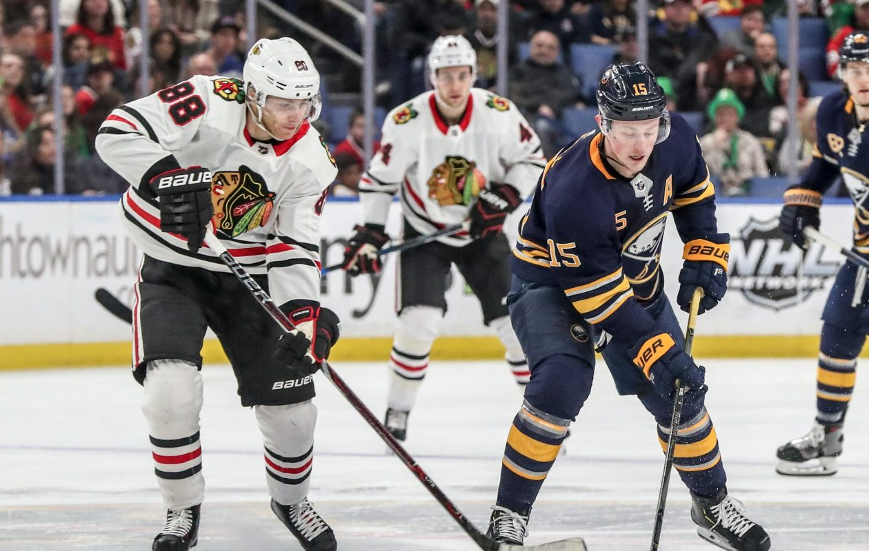 Patrick Kane, left, battles Jack Eichel for the puck Saturday (James P. McCoy/Buffalo News)