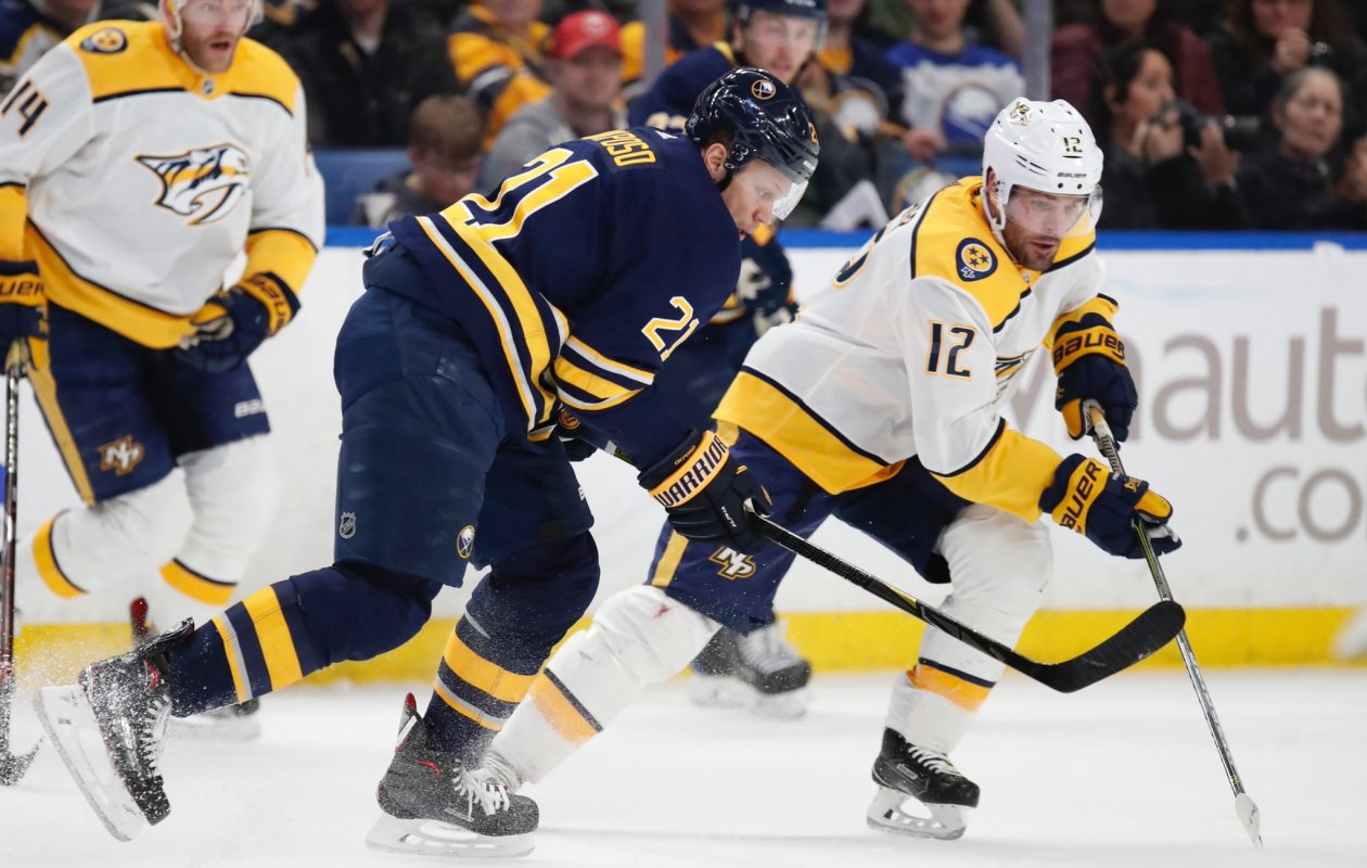 The Sabres' Kyle Okposo and the Predators' Mike Fisher chase a loose puck Monday. (Harry Scull Jr./Buffalo News)
