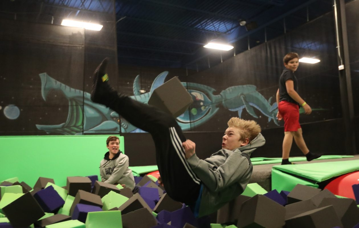 Ryan Herzog, 12, lands after a flip off the trampoline at Get Air trampoline park. (Sharon Cantillon/Buffalo News)