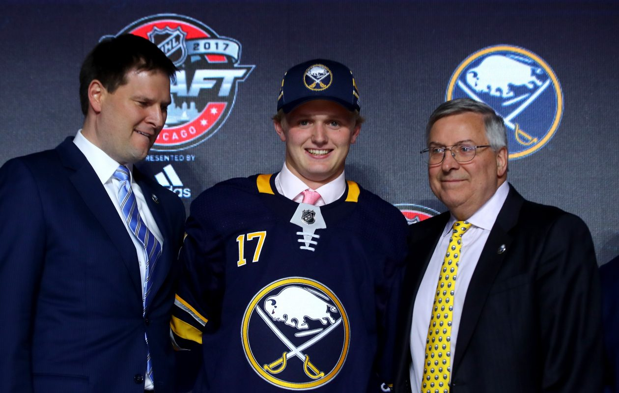 Casey Mittelstadt, with Sabres General Manager Jason Botterill (left) and owner Terry Pegula, was the No. 8 overall pick in the 2017 NHL Draft. (Getty Images)