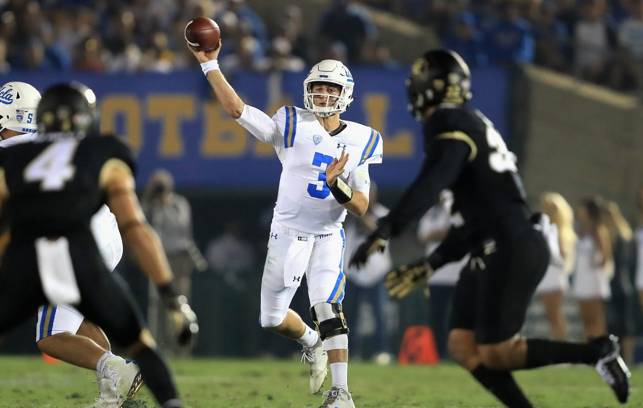 Josh Rosen of the UCLA Bruins passes as Dante Wigley (4) of the Colorado Buffaloes defends during the first half of a game at the Rose Bowl on September 30, 2017, in Pasadena, Calif. (Sean M. Haffey/Getty Images)