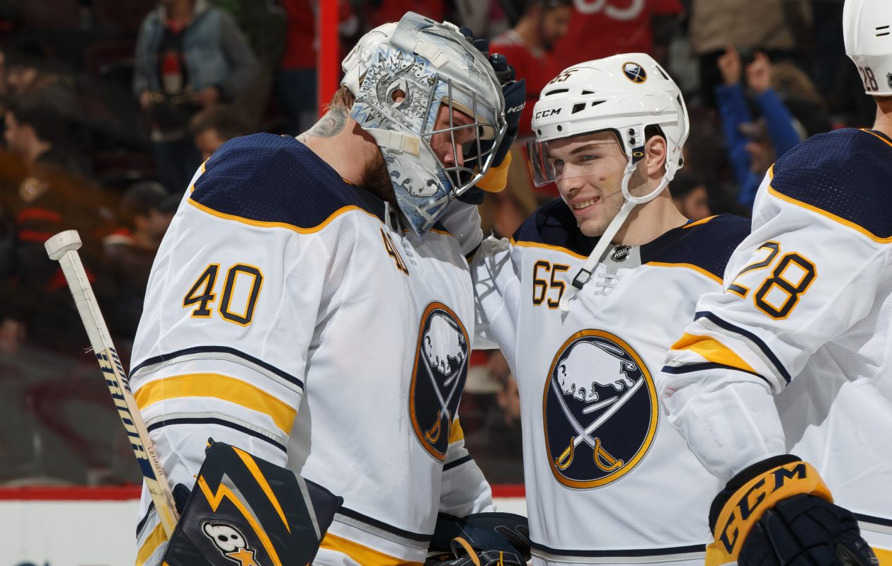 Robin Lehner and Danny O'Regan celebrate the Sabres' 4-3 overtime victory over the Senators. (Getty Images)