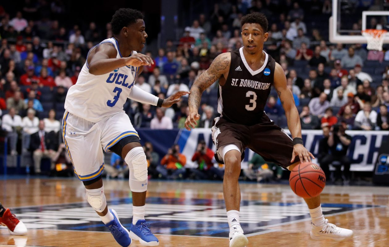 Jaylen Adams #3 of the St. Bonaventure Bonnies is defended by Aaron Holiday #3 of the UCLA Bruins during the second half of the First Four game in the 2018 NCAA Men's Basketball Tournament at UD Arena on March 13, 2018 in Dayton, Ohio. The St. Bonaventure Bonnies defeated the UCLA Bruins 65-58.  (Getty Images)