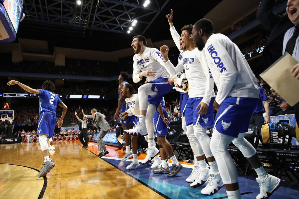The Buffalo Bulls bench celebrates a three point basket in the second half against the Arizona Wildcats during the first round of the 2018 NCAA Men's Basketball Tournament at Taco Bell Arena on March 15, 2018 in Boise, Idaho.  (Photo by Ezra Shaw/Getty Images)