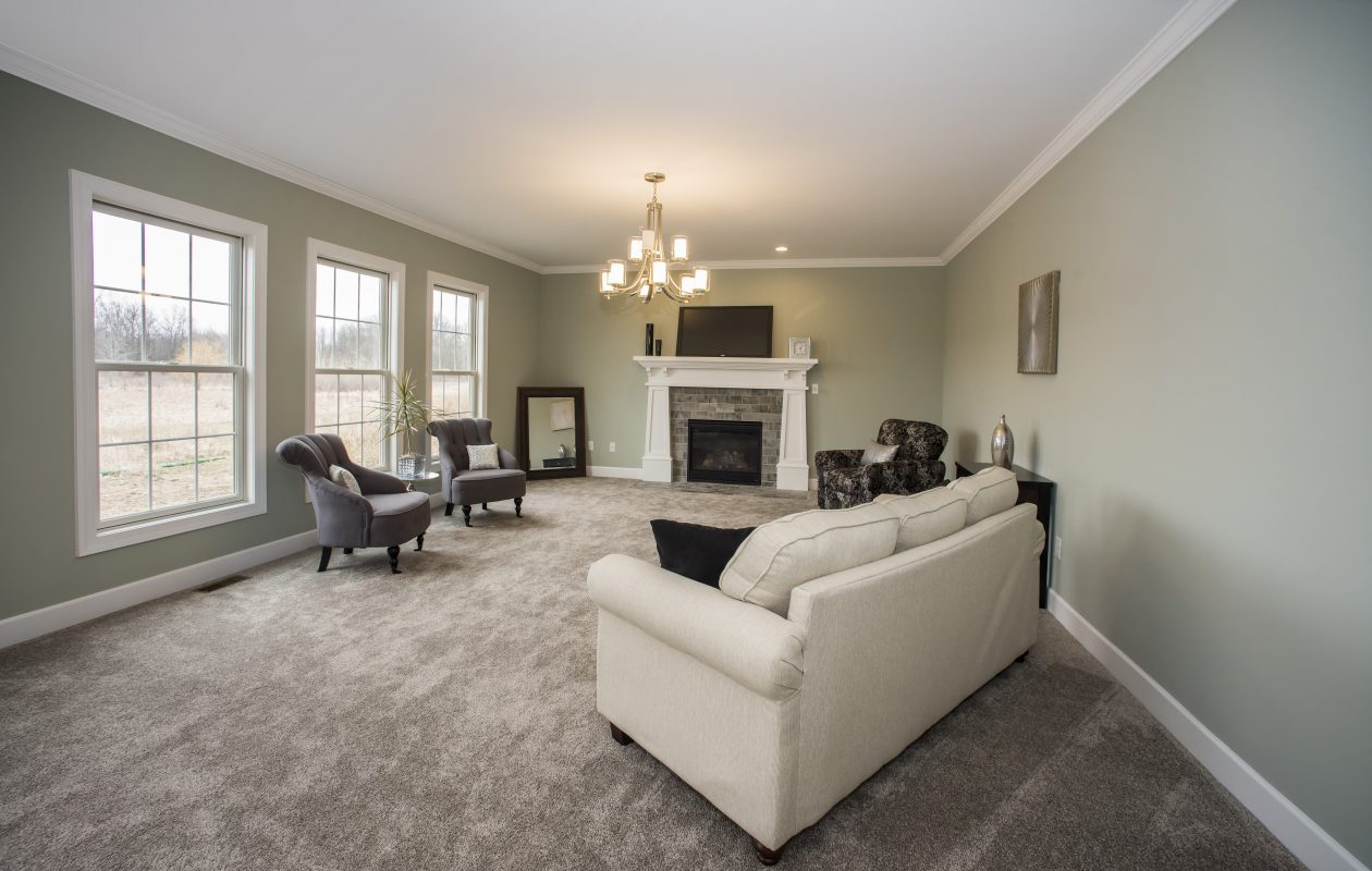 The living room with a gas fireplace and plenty of windows lets natural light in. (Photos Jim Lesinski)