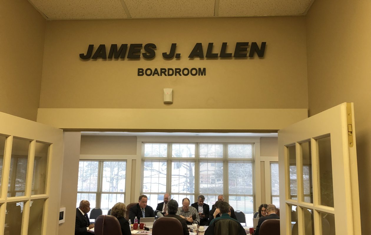 The name of James J. Allen, the longtime executive director of the Amherst IDA who died in October, marks the entrance to the IDA's boardroom. (Buffalo News/Stephen T. Watson)