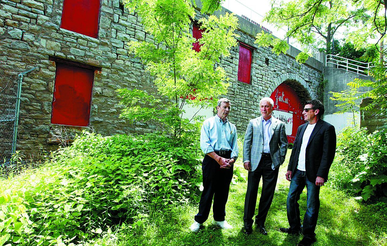 Lockport professionals who intend to restore the old Electric Building near the Erie Canal locks, from left, Jeff Schratz, Dr. Todd Retell, president of the Historic Lockport Millrace Corp.,and Dr. James M. Shaw, secretary, at the  Old Electric Building  in Lockport, N.Y., on Wednesday, June 24, 2015. (John Hickey/Buffalo News)