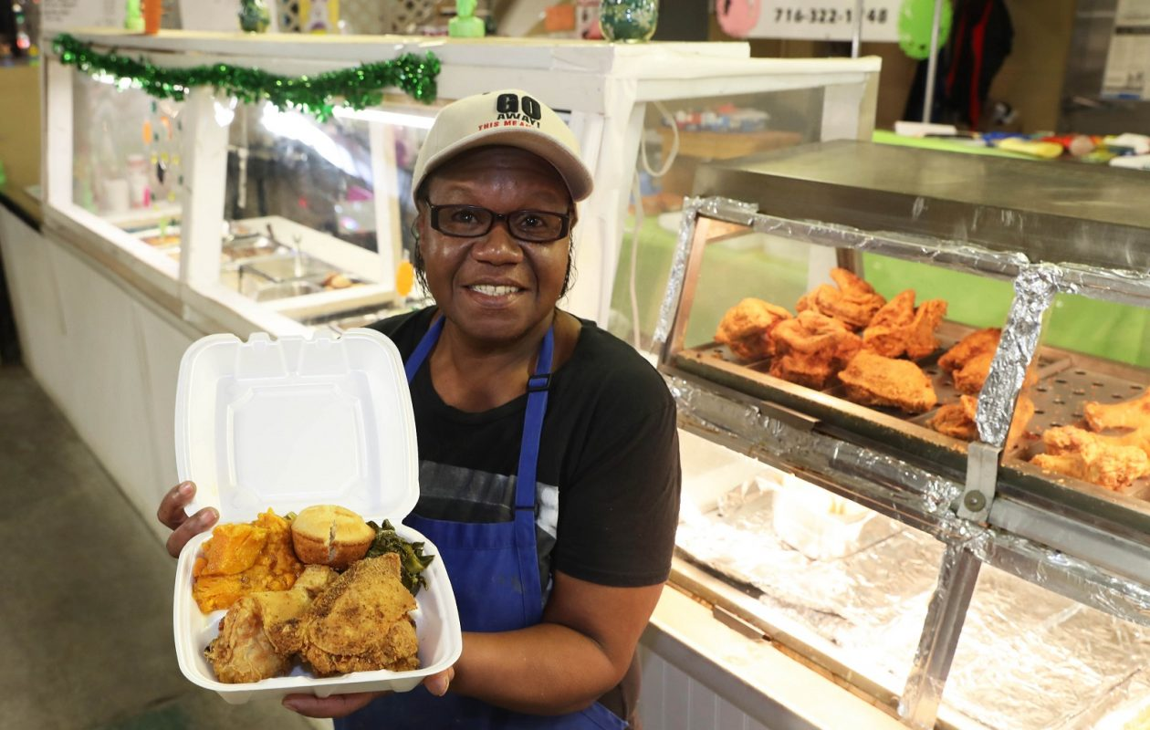 Margie Hawkins, owner of Margie's Soul Food at the Broadway Market, shows off a fried chicken dinner.  (Sharon Cantillon/Buffalo News)