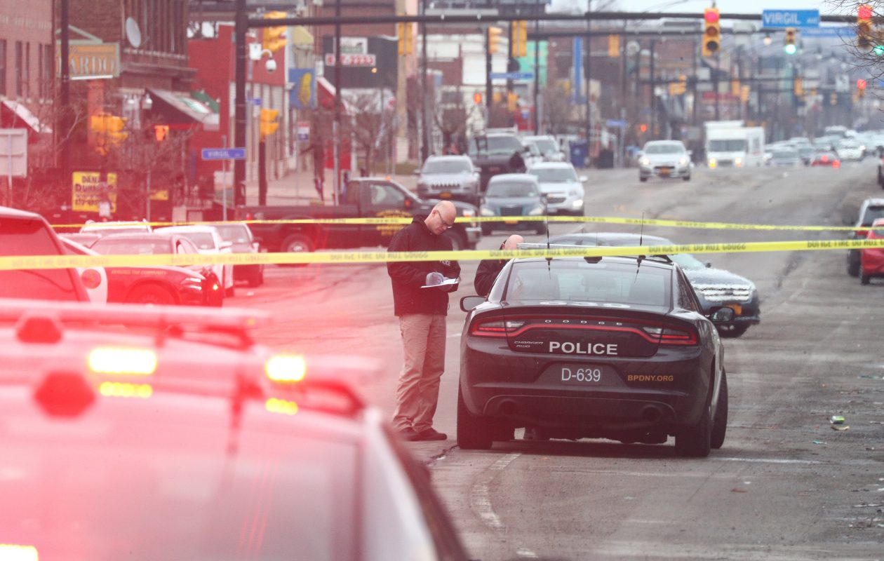 State Police investigate a fatal accident at Hertel  by Tennyson avenues  in Buffalo on  Friday,  March 30, 2018, involving a Buffalo Police car and a 60-year-old woman pedestrian.  (John Hickey/Buffalo News)