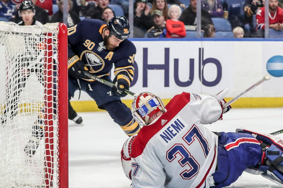 Ryan O'Reilly tries to get the puck past Montreal goalie Antti Niemi (James P. McCoy/Buffalo News).