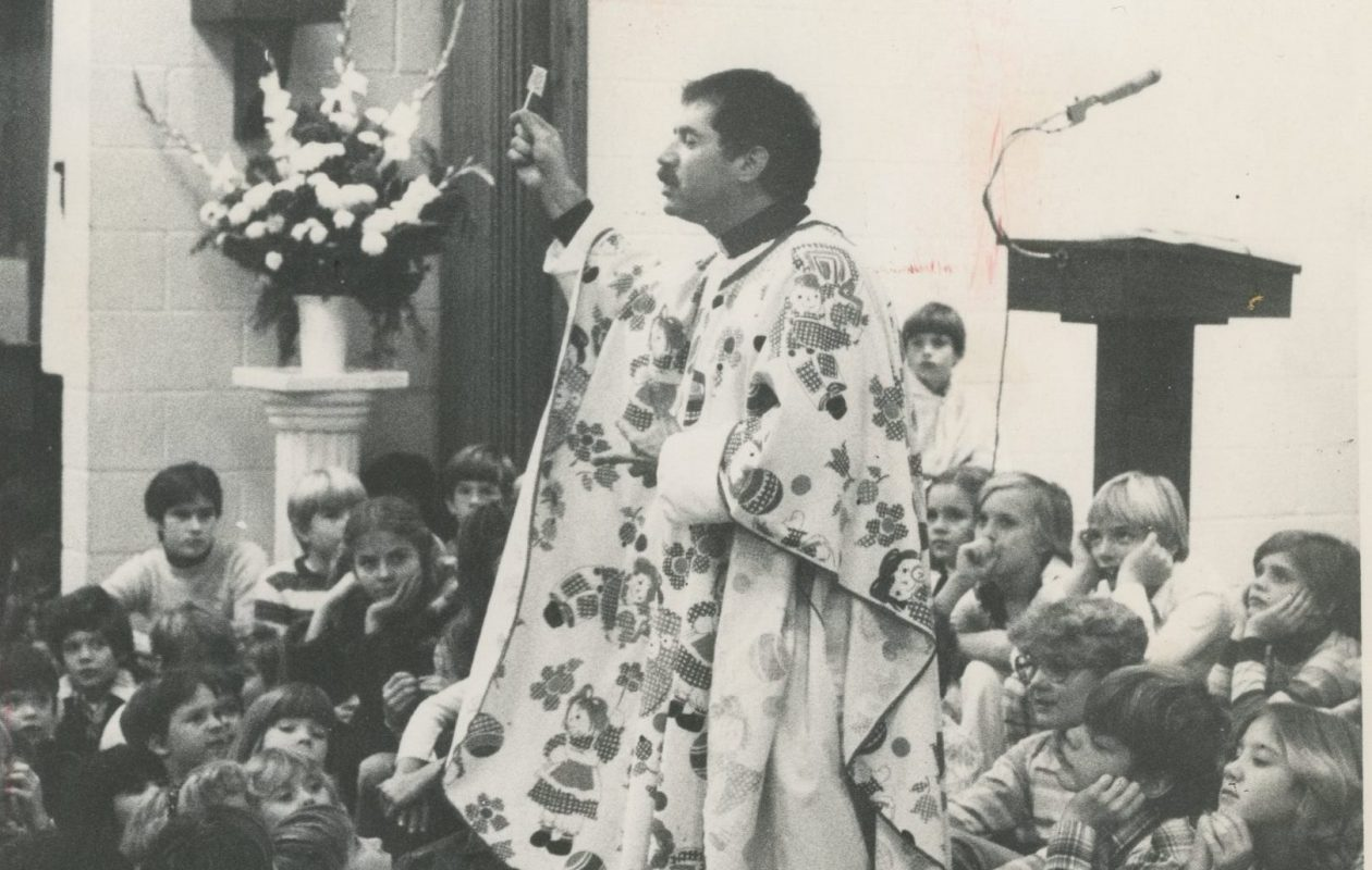 The Rev. John Aurelio talks to a group of children at St. Catherine of Siena Church in West Seneca in 1979. (News file photo)